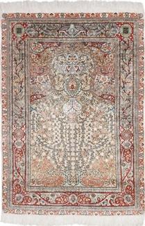 fine metal silk hereke rug