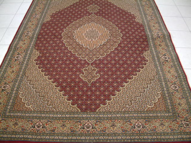 Tabriz Persian rug #1143, click on the picture or description for more details about the Persian carpets.