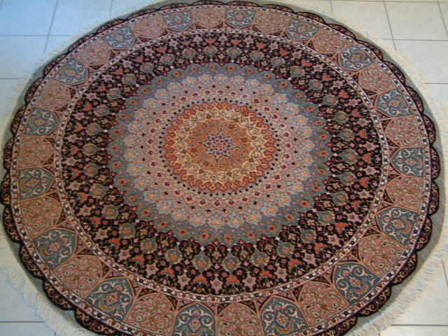 Tabriz Persian rug #1240, click on the picture or description for more details about the Persian carpets.