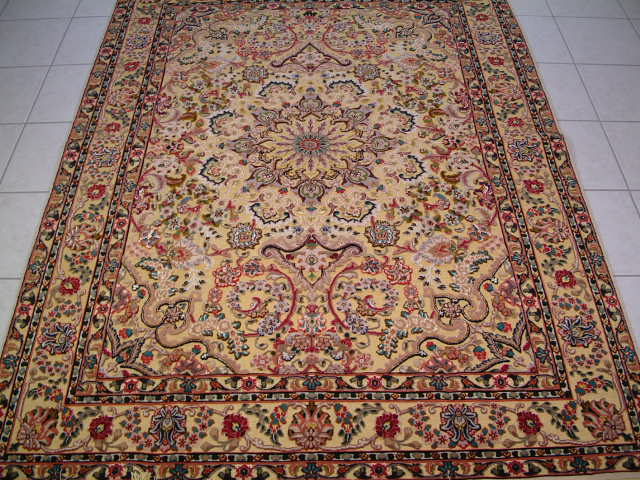 Tabriz Persian rug #1189, click on the picture or description for more details about the Persian carpets.