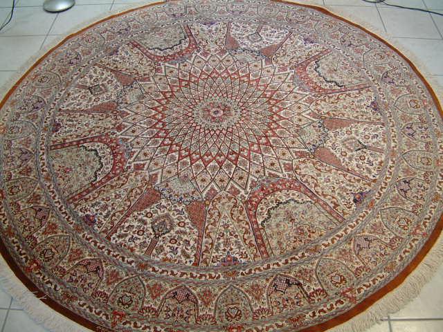 Round pure silk Qom Persian rug with a Gonbad design.