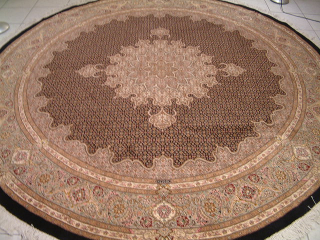 Tabriz Persian rug #1210, click on the picture or description for more details about the Persian carpets.