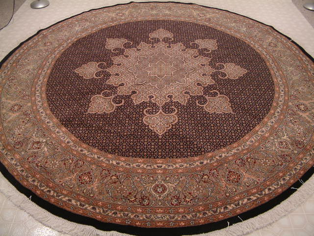Tabriz Persian rug #1233, click on the picture or description for more details about the Persian carpets.