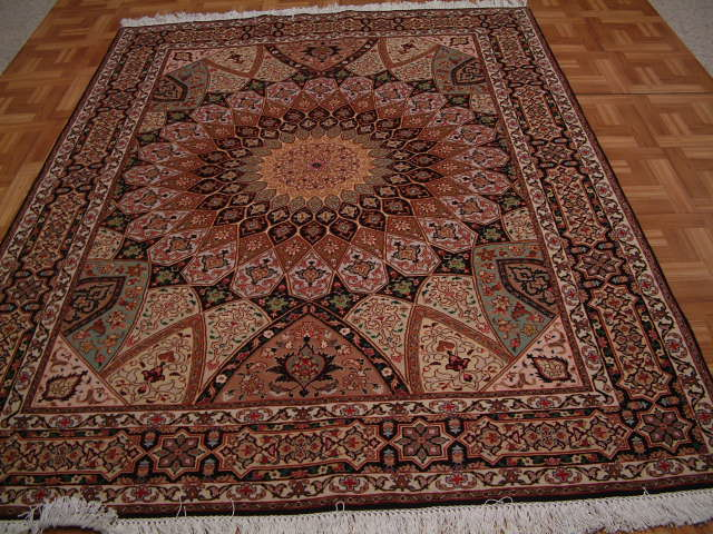 Tabriz Persian rug #1245, click on the picture or description for more details about the Persian carpets.