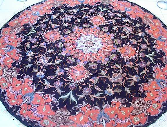 Tabriz Persian rug #1106, click on the picture or description for more details about the Persian carpets.