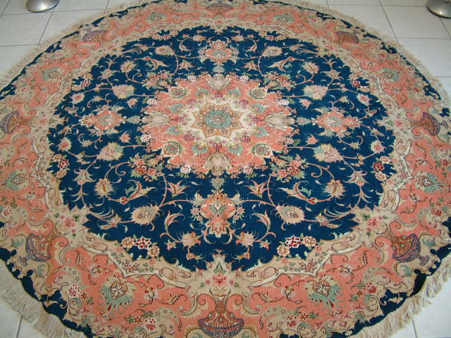 Tabriz Persian rug #1165, click on the picture or description for more details about the Persian carpets.