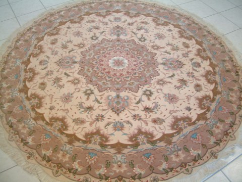 Tabriz Persian rug #1169, click on the picture or description for more details about the Persian carpets.