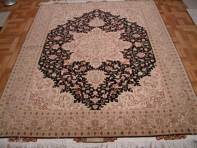 Tabriz Persian rug #1257, click on the picture or description for more details about the Persian carpets.