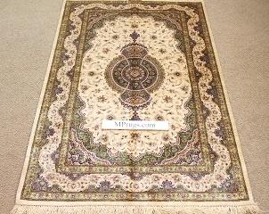 Gorgeous high quality pure silk Qom Persian rug. Genuine handmade silk qum Persian carpet showpiece featuring green and beige colors.