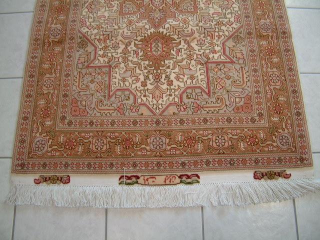 Medium Tabriz Heriz Persian rug; All Persian Rugs are genuine handmade. Also, every Persian Tabriz rug I offer is made with fine kurkwool/silk.