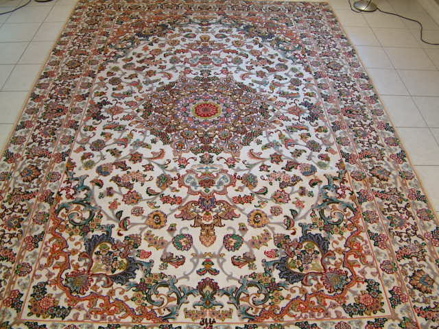 Large Tabriz Persian rug with a silver metal and cotton foundation.