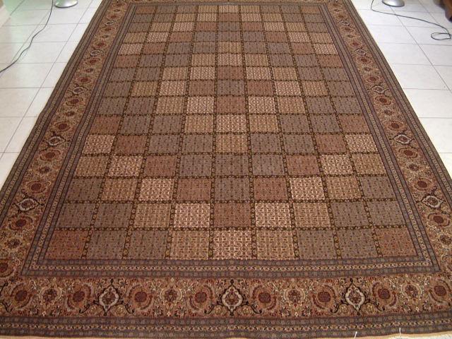 Signed Pirouzian Tabriz Mahi Persian rug.