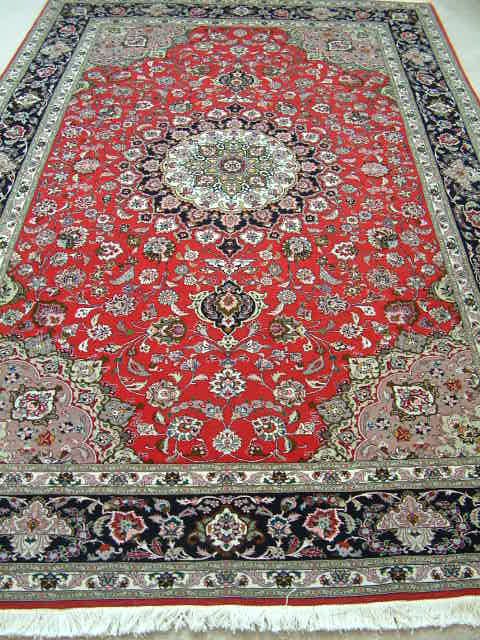 Tabriz Persian rug #5060, click on the picture or description for more details about the Persian carpets.