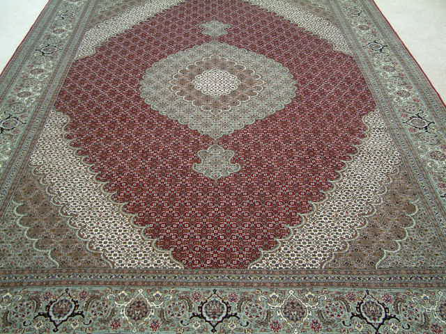 Tabriz Persian rug #5065, click on the picture or description for more details about the Persian carpets.