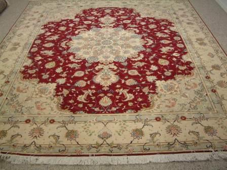 Tabriz Persian rug #5077, click on the picture or description for more details about the Persian carpets.