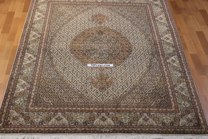 Beige Pirouzian Mahi Tabriz Persian rug. Signed Mahi Tabriz Persian carpet