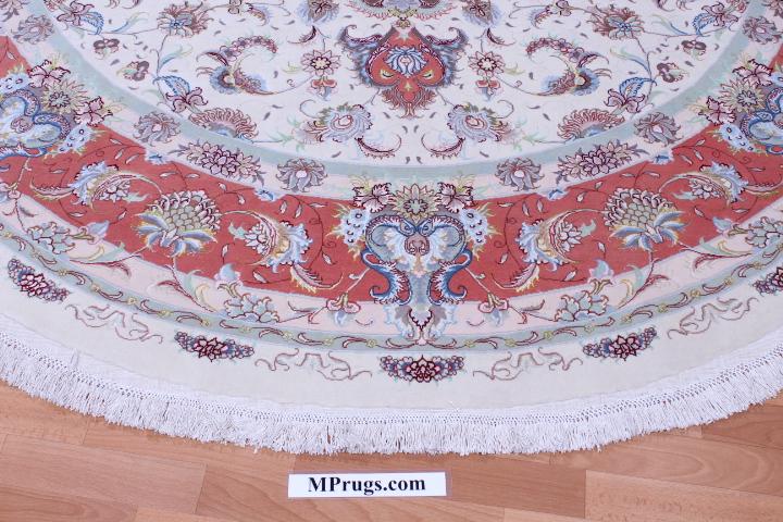 55 Raj round Tabriz Persian rug with a silk foundation. Beige round Tabriz Persian carpet.