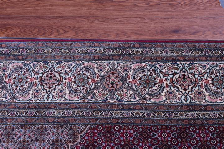 Burgundy red Pirouzian Mahi Tabriz Persian rug. Signed Mahi Tabriz Persian carpet.