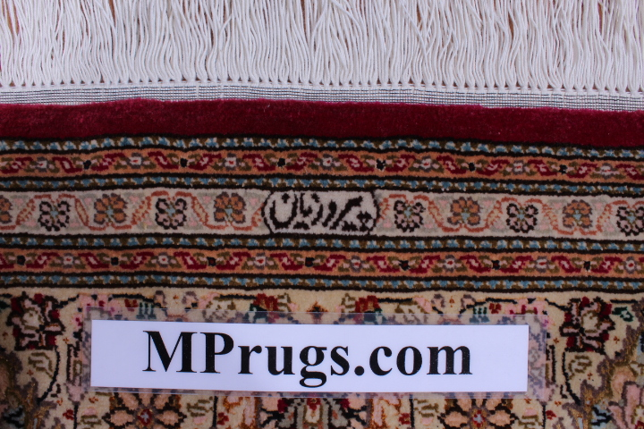 Burgundy red Pirouzian Mahi Tabriz Persian rug. Signed Mahi Tabriz Persian carpet.