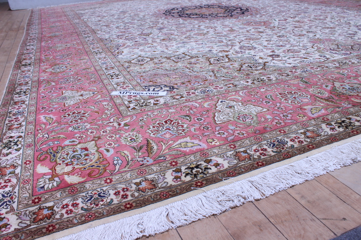 16x11 Tabriz Persian rug with silk highlights.