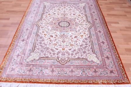 8x5 Light colored 6x4 Qom silk Persian rugs.