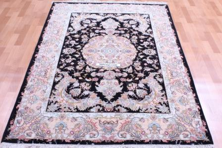 Silk Tabriz Persian rug, silk black Tabriz carpet.