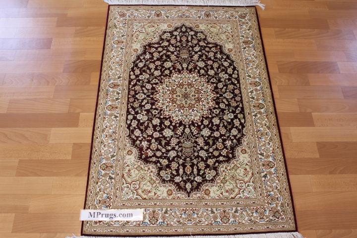 4x2 burgundy qum Persian rug with signature