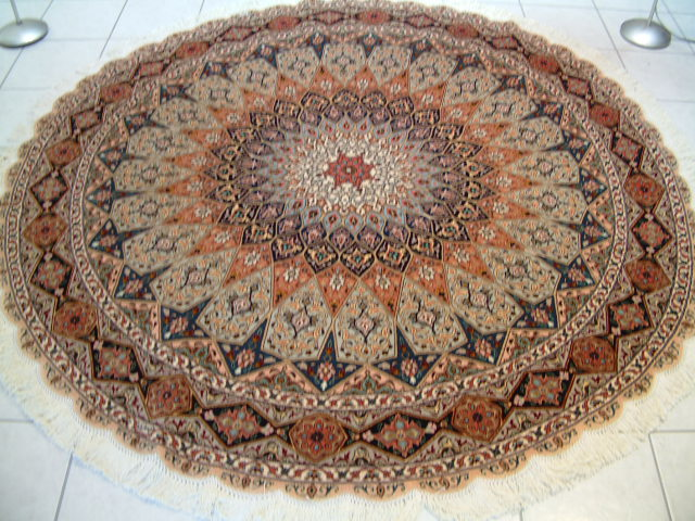 Persian carpets #7. This design in Persian carpets is called Gonbad and is based on the dome shaped ceilings in mosques. Round Persian carpets are very popular and this Tabriz Persian carpet design is among my most popular patterns.