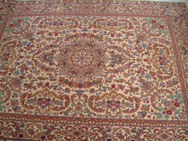 This Tabriz rug measured rawly 10x13 and is among the largest metal persian carpets I have ever offered. In addition to the size, it is made with a silk foundation, which is very hard to do in metal rugs and it is one of the most valuable and expensive oriental carpets I have offered in my business.