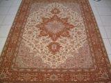 HERIZ ORIENTAL CARPETS. Click on picture or text to read and see more about Heriz Oriental Carpets. This Tabriz Heriz rug is a great example of the geometric design Heriz Persian carpets.