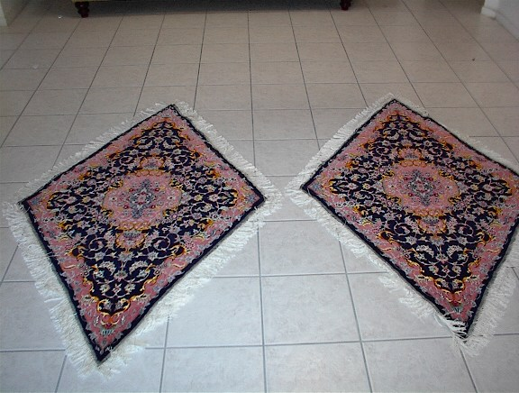Medium sized twin Tabriz oriental rugs with a diamond shape, which is one of the most unique Persian carpets that I have ever offered. My specialty is in rare and truly unique Persian rugs like this set and many of my oriental carpets are so rare that they are actually purchased by other retailers who then turn around and sell them in their stores. Due to my direct family connections in Tabriz, I am able to receive some of the most remarkable Tabriz Persian rugs, which are well known for their at times rare designs.