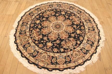 55 Raj Round Tabriz Persian rug with a silk foundation. Round 5' silk Tabriz Persian carpet.
