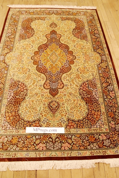6x4 dark colored Qom silk Persian rugs. Pure Silk Qum Persian carpet with creme gold colors.