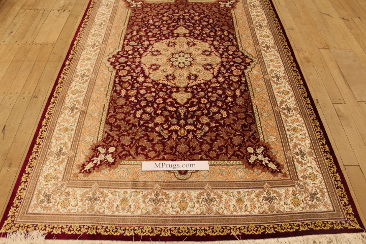 High quality burgundy colored Qom silk Persian rugs. Pure Silk Qum Persian carpet with burgundy colors.