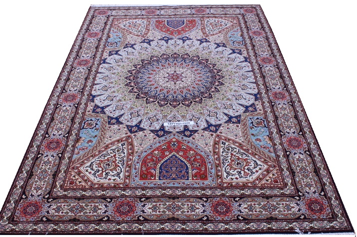 Signed Gonbad Tabriz Persian carpet with silk